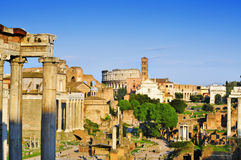 Roman Forum in Rome, Italy. ROME, ITALY - APRIL 17: Roman Forum with the Coliseum in the background on April 17, 2013 in Rome, Italy. The Coliseum is an iconic Royalty Free Stock Images