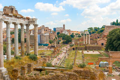 Roman Forum, Rome, Italy. Rome, Italy - August 29, 2014: Tourists entering Roman Forum at Via Sacra in Rome Italy on August 29, 2014 Royalty Free Stock Image