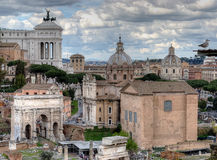 Roman Forum, Rome, Italy. Roman Forum. Monument of Vittorio Emanuele II, Arch of Septimius Severus and Church of Saints Luke and Martina. Italy Royalty Free Stock Image