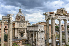 Roman Forum, Rome, Italy. View over the ancient Forum of Rome showing temples, pillars, the senate and ancient streets Royalty Free Stock Images