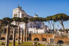 Roman forum ruins with Altare della Patria. (Altar of the Fatherland) building on background, Rome, Italy royalty free stock image