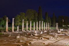 Roman Forum Ruins in Aquileia. Night view of the columns of the ancient Roman Forum Ruins in Aquileia, Friuli, Italy Stock Photos