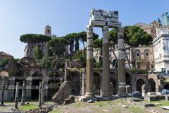 Roman Forum ruins in Rome, Italy. The Roman Forum is a rectangular forum surrounded by the ruins of several important ancient government buildings at the center Stock Photo