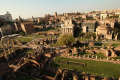 The roman forum seen from above. The roman forum at sunset seen from above. Although a lot of it is in ruin there are still structures that kept their shape and Royalty Free Stock Photos