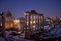 Roman Forum in the snow. This is a striking view of the Roman Forum in the snow. The atmosphere is magical in the Eternal City Royalty Free Stock Images