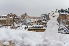 Roman Forum and snowman royalty free stock image