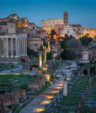 Roman Forum at sunset as seen from the Campidoglio Hill. The Roman Forum, also known by its Latin name Forum Romanum, is a rectangular forum surrounded by the Royalty Free Stock Photography