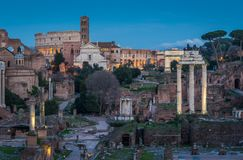 Roman Forum at sunset as seen from the Campidoglio Hill. The Roman Forum, also known by its Latin name Forum Romanum, is a rectangular forum surrounded by the Stock Image