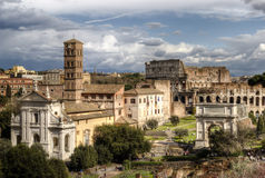 Roman Forum. The Temple of Venus and Roma, Church of Santa Francesca Romana, The Arch of Titus, The Colosseum. Rome, Italy Royalty Free Stock Images