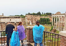 Roman Forum tourists Rome Italy. Tourists sightseeing by the excavated remains of Roman ruins in Roman Forum,Rome Italy Stock Photo