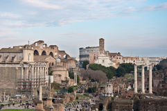 Roman forums with tourists and coliseum on background Royalty Free Stock Photography