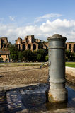 Roman fountain. Nasone (typical Roman fountain) in front of the Palatine Hill in Rome, Italy Royalty Free Stock Image