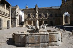 Roman fountain of the lions of Baeza. The ancient fountain of the lions in the place of the populo in the city of Baeza, was built with ancient lions in Stock Images