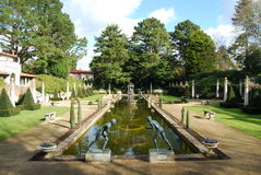 Roman Garden with statues. Neo-Roman garden in Dorset with statues of boys fighting Stock Photos