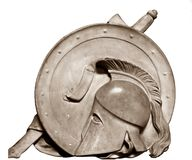 Roman Gladiator Helmet. Marble engraving of Spartan Roman Greek Trojan or Gladiator helmet with plume, shield and sword Stock Photo