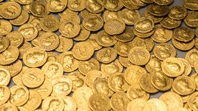Roman gold coins hoard. Full frame abstract background texture of an old Roman gold coin hoard stock photo