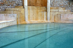 Roman/Greco style indoor pool. A view of an fancy, Roman/Greco style swimming pool, found in Turkey Royalty Free Stock Image