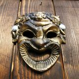 Bacchus mask on the door Royalty Free Stock Photography