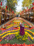 """Antigua Easter Procession. Roman guards line a traditional street carpet or """"alfombra"""" during """"Semana Santa"""" Easter celebrations in Antigua, Guatemala Royalty Free Stock Photos"""