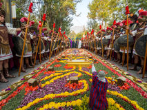 """Antigua Easter Procession - Landscape. Roman guards line a traditional street carpet or """"alfombra"""" during Semana Santa easter celebrations in Antigua, Guatemala Royalty Free Stock Photography"""