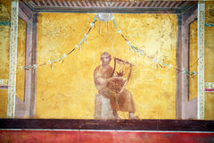 Roman harp. A ancient roman fresco inside the villa of oplontis in italy Royalty Free Stock Image