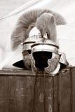 Roman helmet. Two roman helmets on a case of wood Stock Photography