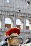 Roman helmet in front of Colosseum in Italy Royalty Free Stock Photo