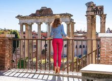 Elegant woman in front of Roman Forum exploring attractions Stock Images