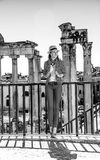 Tourist woman near Roman Forum in Rome, Italy having excursion. Roman Holiday. Full length portrait of smiling stylish tourist woman near Roman Forum in Rome Stock Photo