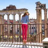 Tourist woman near Roman Forum in Rome, Italy having excursion. Roman Holiday. Full length portrait of stylish tourist woman near Roman Forum in Rome, Italy Stock Photo
