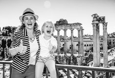 Smiling mother and child tourists in Rome showing thumbs up Royalty Free Stock Photos