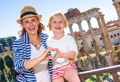 Mother and daughter tourists in Rome showing heart shaped hands Royalty Free Stock Photography