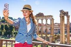 Traveller woman in Rome taking selfie with cellphone Stock Image