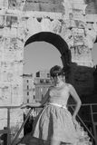 The girl on the background of the walls of the Colosseum Rome Italy Royalty Free Stock Photo