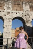 The girl on the background of the walls of the Colosseum Rome Italy Stock Images