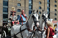 Roman horse drawn carriage. London, Granary Square  - August 31, 2014: during the Battle Bridge event at King's Cross, people are invited to join a horse draw Royalty Free Stock Photography