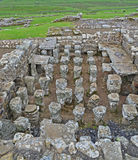 Roman Hypocaust. A view of the hypocaust system for heating rooms in important Roman buildings. This one is located at the Roman cavalry fort at Housesteads( Stock Photos