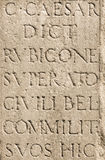 Roman Latin Letters. Detail of a stone commemorating Julius Caesar Royalty Free Stock Photo