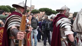 Roman Legion. ROME, ITALY - APRIL 19, 2015:  Group of legionaries guided by centurion, with costumes, weapons, armor and various objects of ancient Rome stock footage