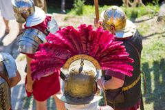 Roman Legionary Helmet. Roman legionary helmet ornate with red feathers Royalty Free Stock Image