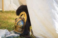 Roman Legionary Helmet. Roman Legionary Helmet at the entrance of a white canvas tent Stock Images