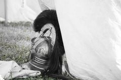 Roman Legionary Helmet. Roman Legionary Helmet at the entrance of a white canvas tent Stock Photos