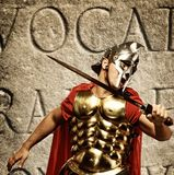 Roman legionary soldier. In front of abstract wall Stock Images