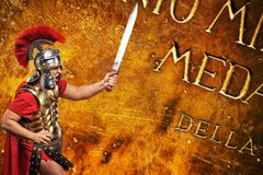 Roman legionary soldier. In front of abstract background Royalty Free Stock Photography