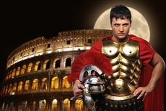 Roman legionary soldier. In front of coliseum at night time Royalty Free Stock Photos