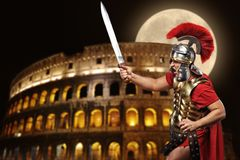 Roman legionary soldier. In front of coliseum at night time Royalty Free Stock Photography