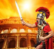 Roman legionary soldier. In front of coliseum Stock Image