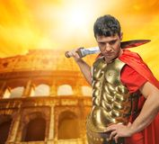 Roman legionary soldier. In front of coliseum Royalty Free Stock Photography