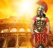 Roman legionary soldier. In front of coliseum Royalty Free Stock Photo