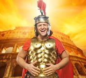 Roman legionary soldier. In front of coliseum Royalty Free Stock Images
